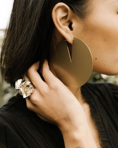 Awesome earrings in a variety of sizes and colors with a folded ring.
